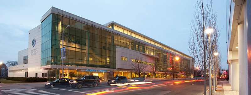An exterior view of the Stamford Campus at night.